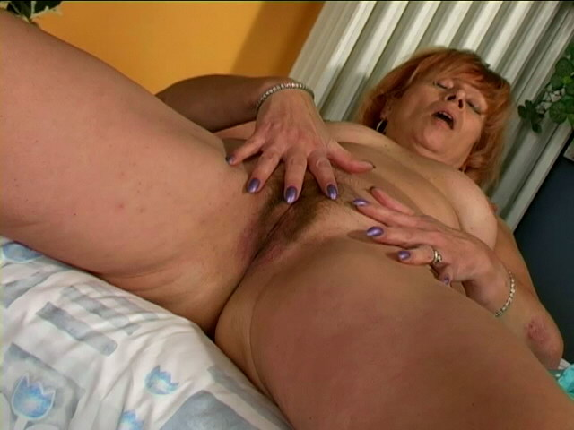Sexually Aroused Grandma Woman Unwrapping Blue Undies And Frigging Her Furry Twat